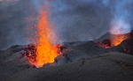 Lava erupts from the Piton de la Fournaise 'Peak of the Furnace' volcano, on the southeastern corner of the Indian Ocean island of Reunion Saturday, Aug. 1, 2015. (AP/Ben Curtis)