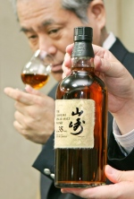 Japan's liquor giant Suntory displays a bottle of the Yamazaki single malt whisky, aged 35 years. (AFP/ Kazuhiro Nogi)