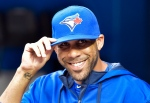 Toronto Blue Jays newly acquired starting pitcher David Price smiles in the dugout as his team plays against the Kansas City Royals during first inning AL baseball action in Toronto on Friday, July 31, 2015. (Nathan Denette / The Canadian Press)