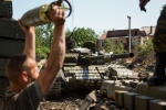 A Russia-backed rebel loads shells in a tank at Donetsk airport, eastern Ukraine, Friday, June 12, 2015. (AP/Mstyslav Chernov)