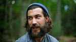 In this Friday, Aug. 7, 2015 photo, Appalachian Trail thru-hiker Karl Berger rests at a campsite in Maine's Baxter State Park, a day before completing the 2,189-mile hike. Berger's beard attests to the months he spent hiking the Appalachian Trail. (AP/Robert F. Bukaty)