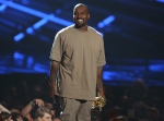 Kanye West accepts the video vanguard award at the MTV Video Music Awards at the Microsoft Theater in Los Angeles on Sunday, Aug. 30, 2015. (Invision / Matt Sayles)