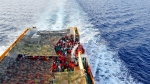 Migrants crowd the deck of the Norwegian Siem Pilot ship sailing along the Mediterranean sea, Wednesday, Sept. 2, 2015. The Siem Pilot is carrying hundreds of migrants rescued in several operations in the Mediterranean sea to the Italian Port of Cagliari. (AP / Gregorio Borgia)