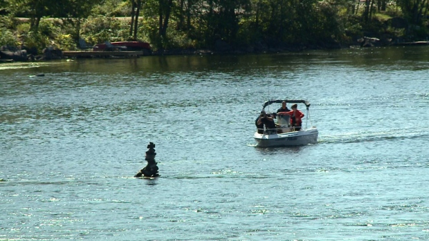 Police in patrol boats search for body.
