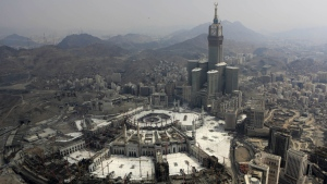 The Abraj Al-Bait Towers with the four-faced clocks stands over the holy Kabaa, as Muslims encircle it inside the Grand Mosque during the annual pilgrimage, known as the hajj, in the Muslim holy city of Mecca, Saudi Arabia on Oct. 5, 2014. (AP / Khalid Mohammed)