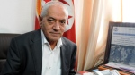 Houcine Abassi, secretary general of the Tunisian General Labour Union (UGTT), poses for a photograph in his office at the headquarters in Tunis, Tunisia, Oct. 9, 2015. (AP)