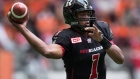 In this September 13, 2015 file photo, Ottawa Redblacks' quarterback Henry Burris passes against the B.C. Lions during the first half of a CFL football game in Vancouver, B.C. (Darryl Dyck/THE CANADIAN PRESS)