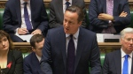"British Prime Minister, David Cameron addresses lawmakers in the House of Commons, London, making his case for airstrikes as part of a ""comprehensive overall strategy"" to destroy IS and end the Syrian war, Thursday, Nov. 26, 2015. (Parliamentary Recording Unit)"