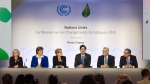 Prime Minister Justin Trudeau speaks during a news conference with Albeta Premier Rachel Notley, B.C. Premier Christy Clark, Ontario Premier Kathleen Wynne, Quebec Premier Philippe Couillard and Saskatchewan Premier Brad Wall at the United Nations climate change summit Monday, Nov. 30, 2015 in Le Bourget, France. (Adrian Wyld / THE CANADIAN PRESS)