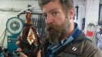 This bottle of Glacial Extinction Mammoth beer was hand-made for Storm Brewing in Vancouver, and wrapped in a mammoth-tusk pendant. The bottles are being sold for $1,000 each. (Twitter / Adam Chatburn)