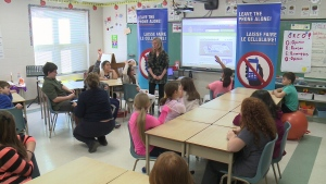 Students learn about the dangers of distracted driving at Chapel Hill Catholic School in Ottawa, Feb. 2, 2016