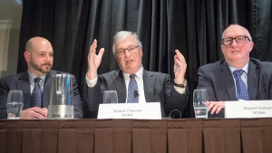 Rona Chairman Robert Chevrier, centre, speaks to reporters as Lowe's International president Richard Maltsbarger, left, and Rona chief executive Robert Sawyer, right, look on at a news conference in Montreal, Wednesday, Feb. 3, 2016. (Ryan Remiorz / THE CANADIAN PRESS)