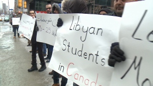 Students protest outside the Libyan embassy in Ottawa, Feb. 3, 2016