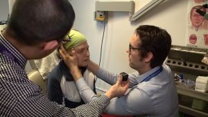 Dr. Darren Tse, the otolaryngologist who founded the Ottawa Hospital's Dizziness Clinic, assesses a patient.