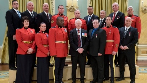Security services members are recognized during a ceremony to pay tribute to their response efforts to the shooting events on Oct. 22, 2014 on Parliament Hill, at Rideau Hall in Ottawa on Monday, Feb. 8, 2016. (Justin Tang / THE CANADIAN PRESS)