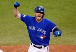 In this Oct. 19, 2015 file photo, Toronto Blue Jays' Josh Donaldson celebrates his two run home run against the Kansas City Royals during the third inning in Game 3 of baseball's American League Championship Series in Toronto. (Paul Sancya / THE CANADIAN PRESS - AP)