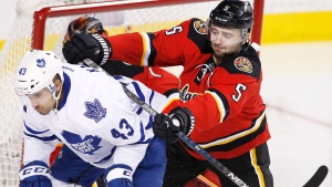 Toronto Maple Leafs' Nazem Kadri, left, is pushed away from the Calgary net by Calgary Flames' Mark Giordano on Feb. 9, 2016. (Larry MacDougal / THE CANADIAN PRESS)
