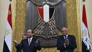 In this photo provided by Egypt's state news agency MENA, Egyptian President Abdel-Fattah el-Sissi, left, addresses parliament in Cairo, Egypt, Saturday, Feb. 13, 2016. El-Sissi, said his country has established a democratic system after years of turmoil following the 2011 uprising, but rights groups say his rule has been marked by an unprecedented crackdown on dissent.(MENA via AP)