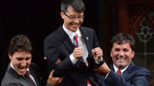 In this file photo, Prime Minister Justin Trudeau and MP Dominic LeBlanc, right, escort Liberal MP Arnold Chan in the House of Commons on Parliament Hill in Ottawa on Sept. 15, 2014. (Sean Kilpatrick/THE CANADIAN PRESS)