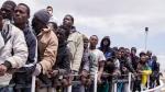 In this Sunday, May 31, 2015 file photo, migrants wait to disembark from the Italian Coast Guard ship Peluso, onto the tiny Italian island of Lampedusa. (AP / Mauro Buccarello, File)