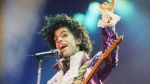 """In this Feb. 18, 1985 file photo, Prince performs at the Forum in Inglewood, Calif. Prince, widely acclaimed as one of the most inventive and influential musicians of his era with hits including """"Little Red Corvette,"""" ''Let's Go Crazy"""" and """"When Doves Cry,"""" was found dead at his home on Thursday, April 21, 2016, in suburban Minneapolis, according to his publicist. He was 57. (Liu Heung Shing, File / AP)"""