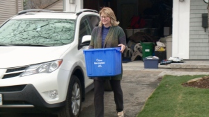 Margaret Fraser takes her recycling to the curb in Ottawa's Manor Park, April 26, 2016