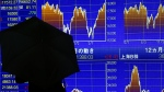 A man looks at an electronic stock indicator of a securities firm in Tokyo, Thursday, April 28, 2016. (AP / Shizuo Kambayashi)
