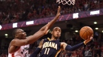 Toronto Raptors' Bismack Biyombo defends as Indiana Pacers' Monta Ellis (11) drives to the basket in Toronto on April 26, 2016. (Frank Gunn / THE CANADIAN PRESS)