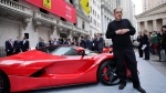 Sergio Marchionne stands with a La Ferrari in front of the New York Stock Exchange on Oct. 21, 2015. (Mark Lennihan / AP)