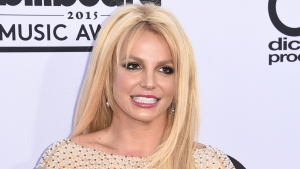 Britney Spears will receive this year's Millennium Award at the Billboard Awards 2016, and will perform a medley of her greatest hits at the event. (AFP PHOTO / ROBYN BECK)