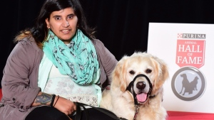 Kayla Aolick and her seizure-response dog, Shadow, seen in a handout photo, were the inaugural recipients of the Better Together Award, presented for the first time at the 2016 Purina Animal Hall of Fame. (HO-Purina Animal Hall of Fame / THE CANADIAN PRESS)