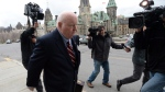 Senator Mike Duffy returned to Parliament Hill in Ottawa Monday and took his seat Tuesday in the Senate for the first time since his suspension.. (Sean Kilpatrick/ The Canadian Press)