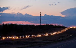 Traffic lines the highway as residents leave Fort McMurray, Alta., on Tuesday May 3, 2016. (Jason Franson / THE CANADIAN PRESS)