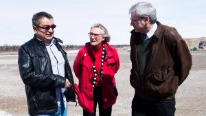 Chief Bruce Shisheesh, left, Minister of Indigenous Affairs Carolyn Bennett, centre, and Federal NDP MPP Charlie Angus, right, meet in the northern Ontario First Nations reserve in Attawapiskat, Ont., on Monday, April 16, 2016. (THE CANADIAN PRESS/Nathan Denette)