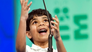 Akash Vukoti, 6, of San Angelo, Texas, reaches for the microphone to spell his word during the preliminary round two of the Scripps National Spelling Bee in National Harbor, Md., Wednesday, May 25, 2016. (AP Photo/Cliff Owen)