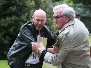 Canadian Ambassador to Ireland Kevin Vickers, right, wrestles with a protester during a State ceremony to remember the British soldiers who died during the Easter Rising at Grangegorman Military Cemetery, Dublin Thursday May 26, 2016. (Brian Lawless / PA)