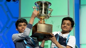 Nihar Janga, 11, of Austin, Texas, and Jairam Hathwar, 13, of Painted Post, N.Y., hold up the trophy after being named co-champions at the 2016 National Spelling Bee, in National Harbor, Md., on Thursday, May 26, 2016. (AP / Jacquelyn Martin)