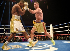 Lucian Bute, right, hits Badou Jack with a left during a boxing bout early Sunday, May 1, 2016, in Washington. (THE CANADIAN PRESS/AP, Nick Wass)