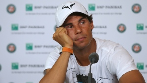Rafael Nadal announces he is pulling out of the French Open because of an injury to his left wrist on May 27, 2016. (Michel Euler / AP)