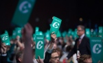 Delegates raise their 'yes' vote cards to change the wording of the traditional definition of marriage in the conservative policies at the Conservative Party of Canada convention in Vancouver, Saturday, May 28, 2016. (Jonathan Hayward / THE CANADIAN PRESS)