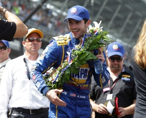 Alexander Rossi smiles after wining the 100th running of the Indianapolis 500 auto race at Indianapolis Motor Speedway in Indianapolis, Sunday, May 29, 2016. (AP Photo/R Brent Smith)