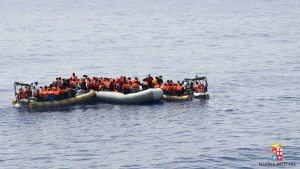 This undated image provided by the Italian Navy Marina Militare shows migrants being rescued at sea.