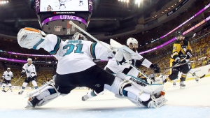 San Jose Sharks goalie Martin Jones (31) defends against Pittsburgh Penguins' Phil Kessel (81) during the second period in Game 1 of the Stanley Cup final series Monday, May 30, 2016, in Pittsburgh. (AP Photo / Bruce Bennett)