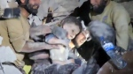 Extended: Child pulled from rubble in Syria