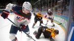 In this May 15, 2016 file photo, United States' Auston Matthews, left, fights for the puck with Germany's Torsten Ankert during a Hockey World Championships Group B match in St. Petersburg, Russia. (AP Photo / Dmitri Lovetsky, File)