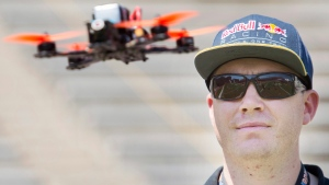 Professional drone racer Ryan Walker pilots a drone during the Montreal drone expo, Saturday, June 25, 2016. (Graham Hughes/The Canadian Press)