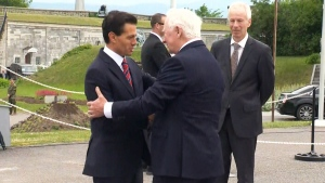 Mexican President Enrique Pena Nieto is greeted by Gov. Gen. David Johnston in Quebec City on Monday, June 27, 2016.