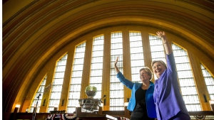Democratic presidential candidate Hillary Clinton, accompanied by Sen. Elizabeth Warren, left, waves after speaking at the Cincinnati Museum Center at Union Terminal in Cincinnati, Monday, June 27, 2016. (Andrew Harnik/ THE ASSOCIATED PRESS)