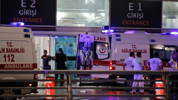 Rescue services gather outside Istanbul's Ataturk airport, Tuesday, June 28, 2016. (AP Photo/Emrah Gurel)