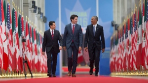 U.S. President Barack Obama walks with Prime Minister Justin Trudeau and Mexican President Enrique Pena Neito at the National Gallery of Canada in Ottawa, on June 29, 2016. (Pablo Martinez Monsivais / AP)